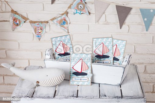 istock Decor in the style of sea travel. Sea thematic photo session decoration of a daylight studio. 843994360