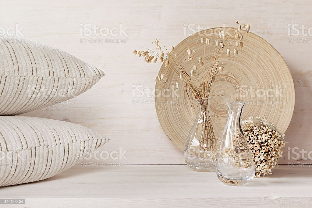 Decor of  glass vase with pillows on white wood background. stock photo
