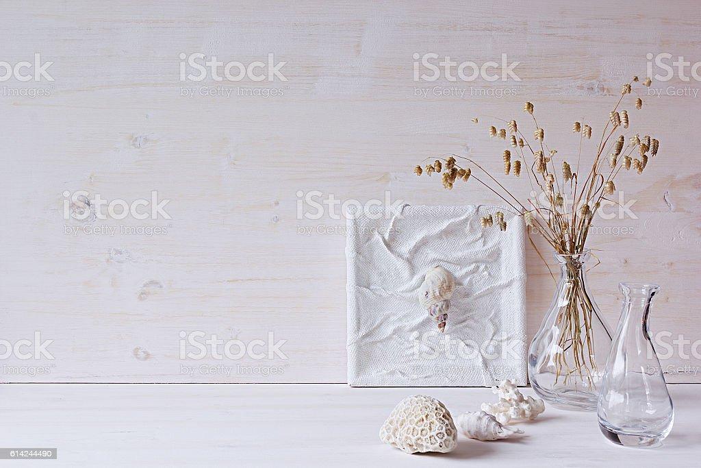 Decor of seashells and vase  on white wood background. stock photo