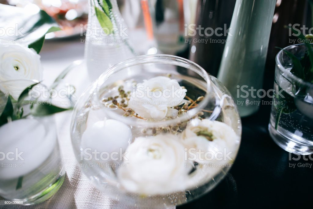 Decor With Beautiful White Flowers In Glass Jars On The Wedding
