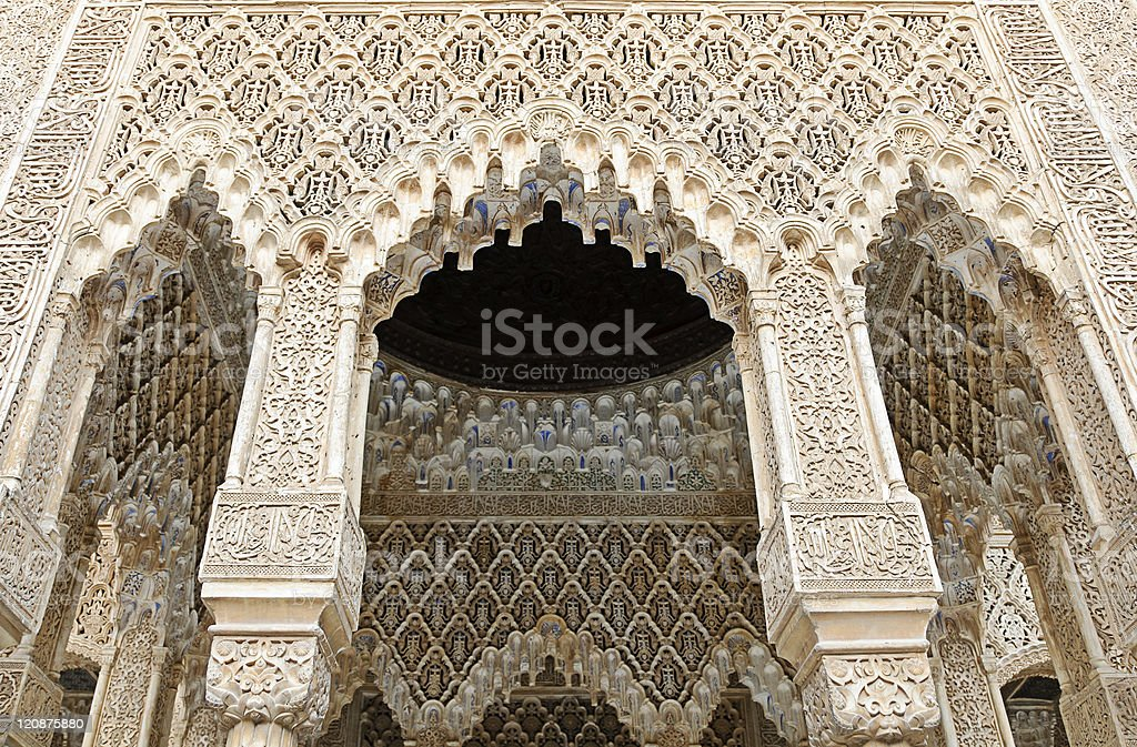 Decorated arches and columns inside the Alhambra of Granada royalty-free stock photo