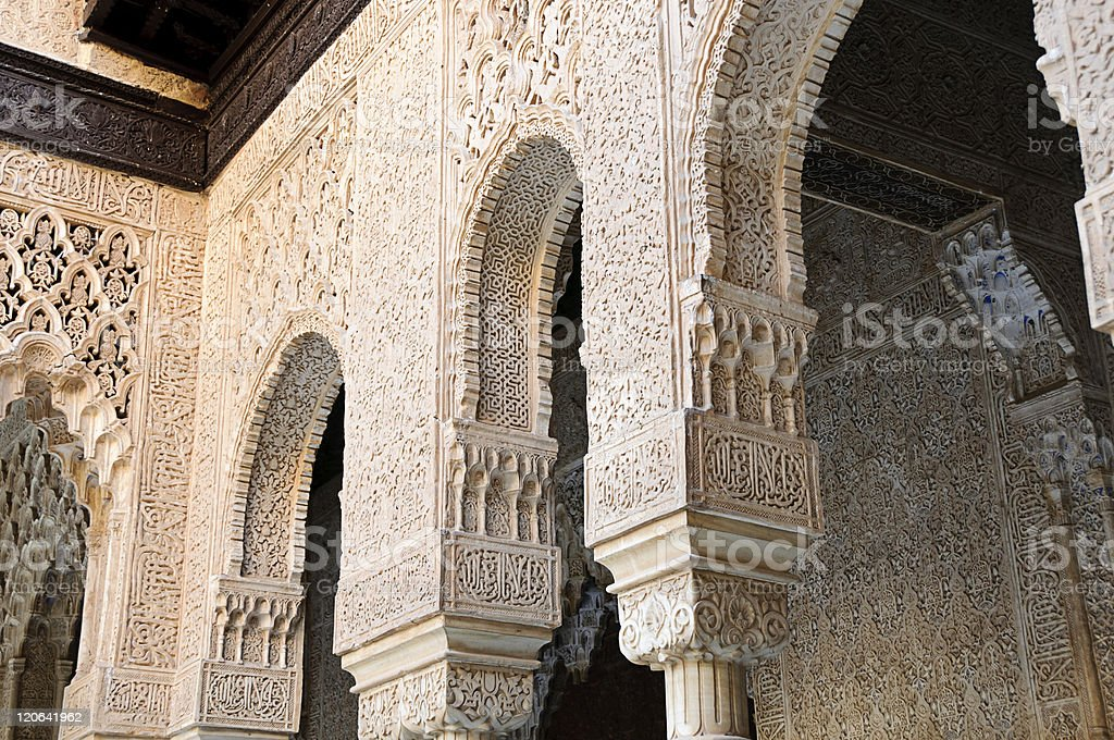 Decorated arches and columns inside the Alhambra of Granada, Spain stock photo