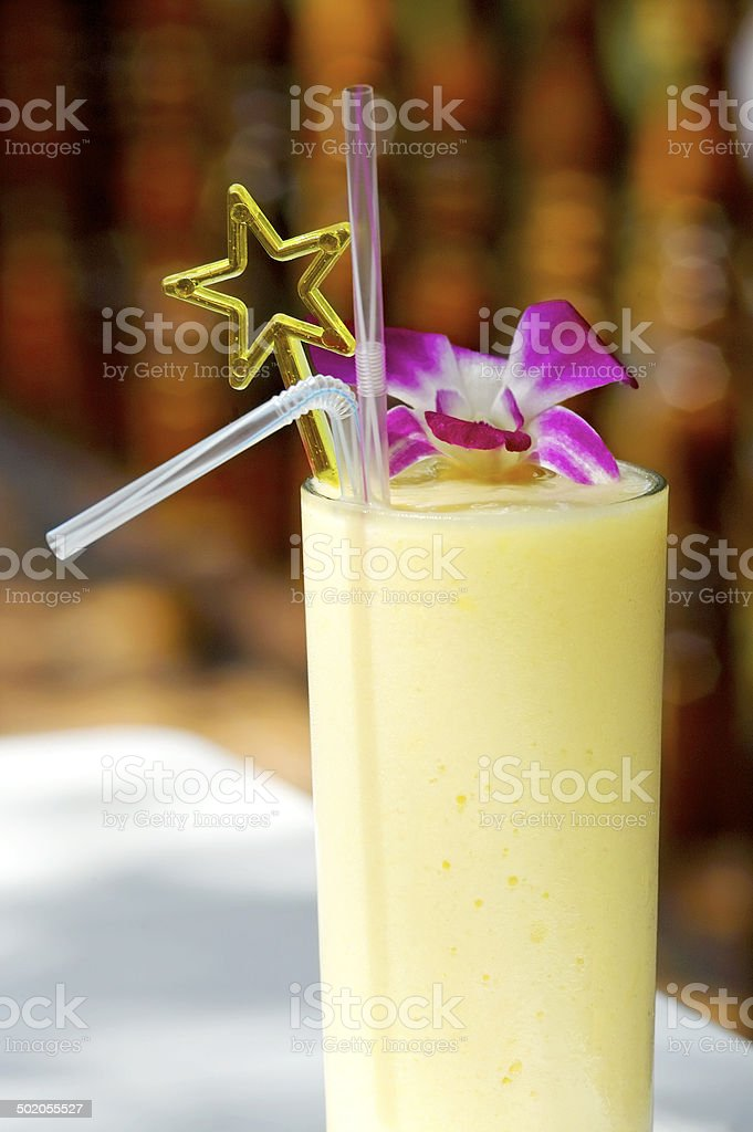 Decorated banana and pineapple smoothie stock photo