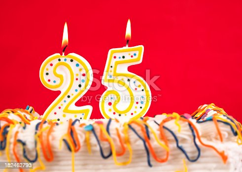 178269167istockphoto Decorated birthday cake with number 25 burning candles. Red background. 182462793