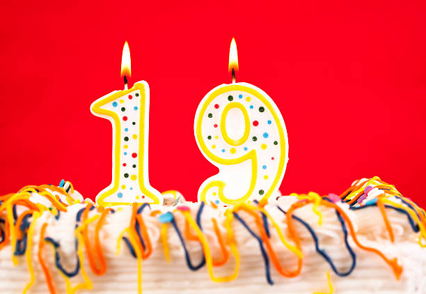 decorated cake  with number 19 burning candles - number 19 stock photos and pictures