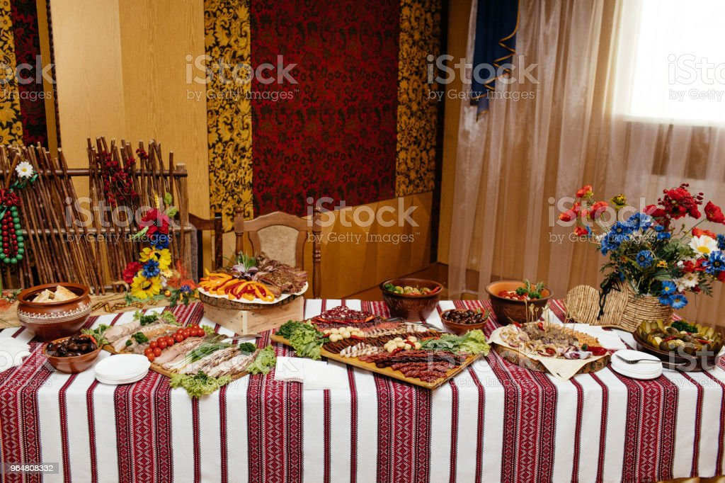 decorated catering banquet table with snacks and different food royalty-free stock photo