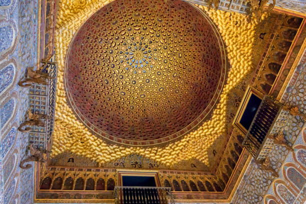 Decorated ceiling in Seville Royal Alcazar Close up view of golden decorated ceiling in Seville Royal Alcazar in Andalusia, Spain. alcazar palace stock pictures, royalty-free photos & images