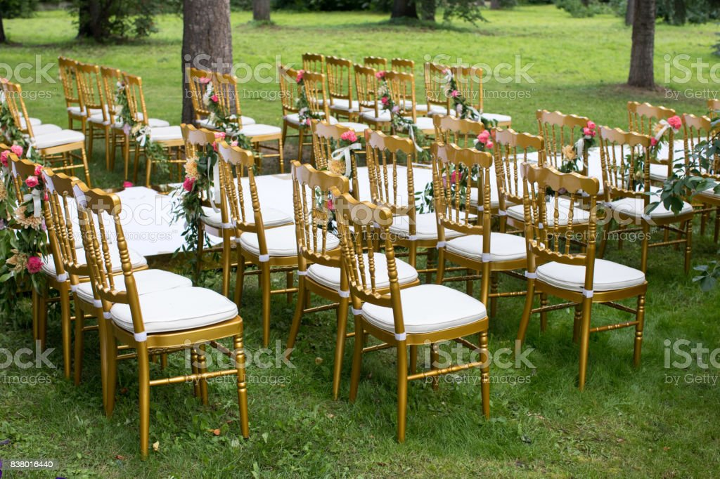 Decorated chairs in garden stock photo