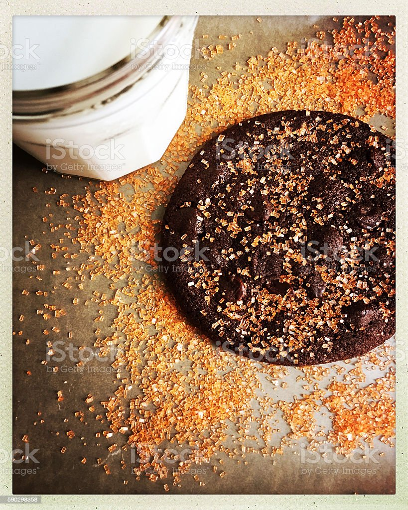Decorated Chocolate Cookie and Glass of White Milk royaltyfri bildbanksbilder