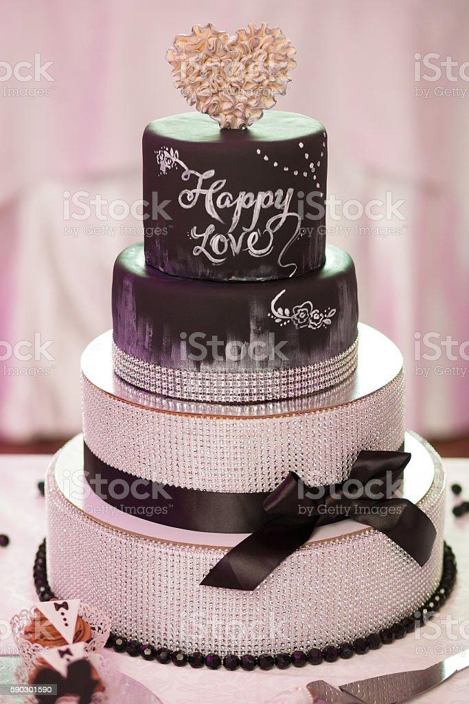Decorated chocolate wedding cake with brown ribbon royaltyfri bildbanksbilder