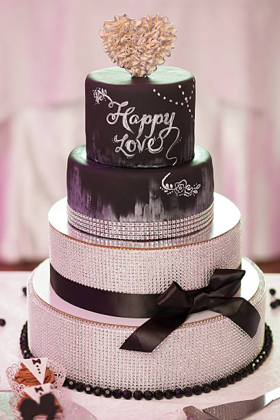 Decorated chocolate wedding cake with brown ribbon stock photo