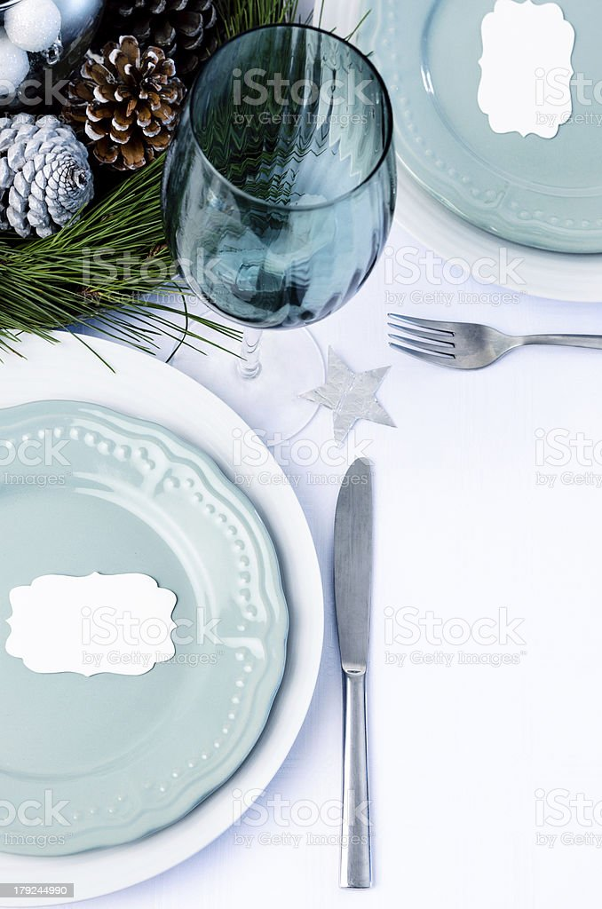 Decorated christmas dinner table setting blue theme royalty-free stock photo