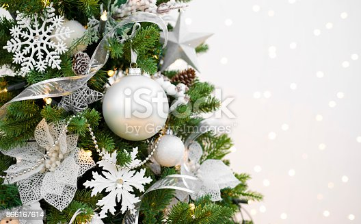 istock Decorated Christmas fir tree on abstract sparkling background with copyspace 866167614