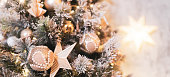 istock Decorated Christmas tree and sparkling and fairy background with toy houses 1248289905