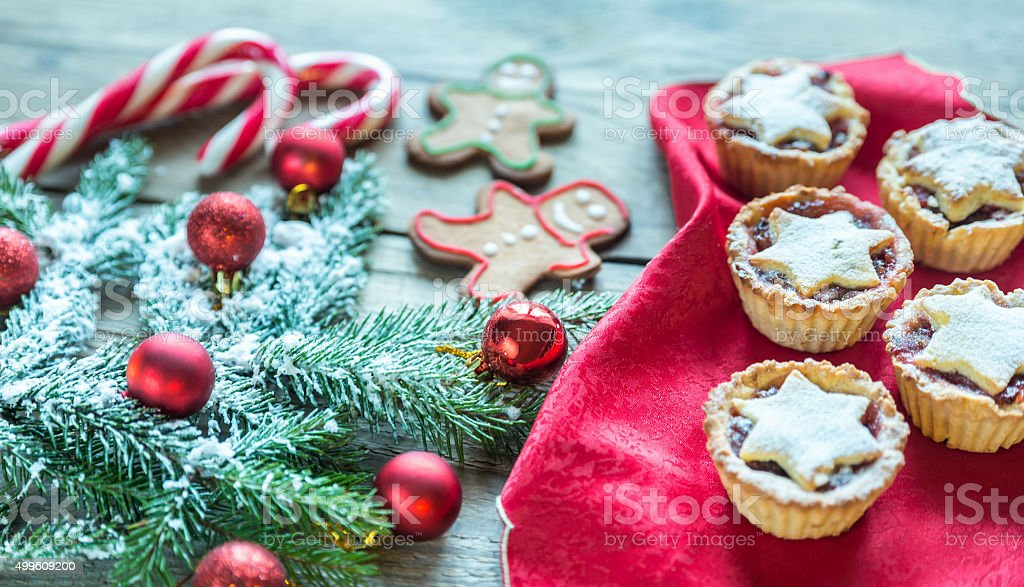 Decorated Christmas tree branch with holiday pastry stock photo