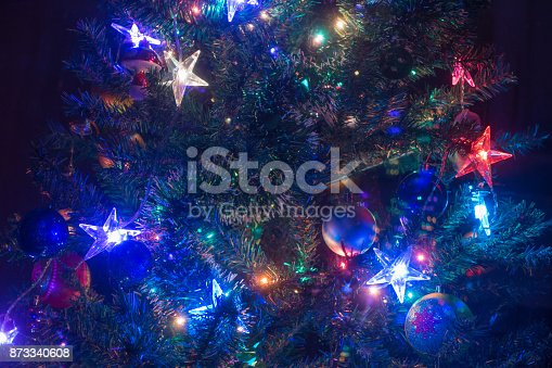 865140324 istock photo Decorated Christmas tree glowing in the night. 873340608