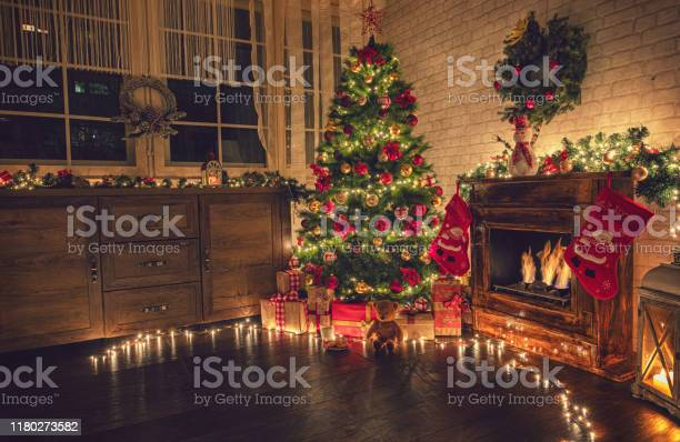 Decorated christmas tree near fireplace at home picture id1180273582?b=1&k=6&m=1180273582&s=612x612&h=fhdys7qtw8m7ly 92v4rbhhdl0mpgrwtg6wnsecowni=