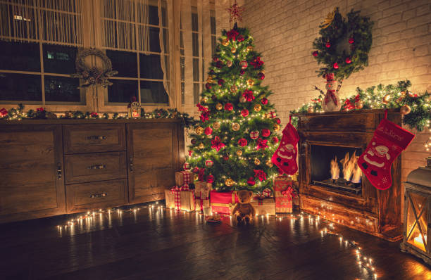 Decorated Christmas Tree Near Fireplace at Home Christmas tree near fireplace in decorated living room christmas tree stock pictures, royalty-free photos & images