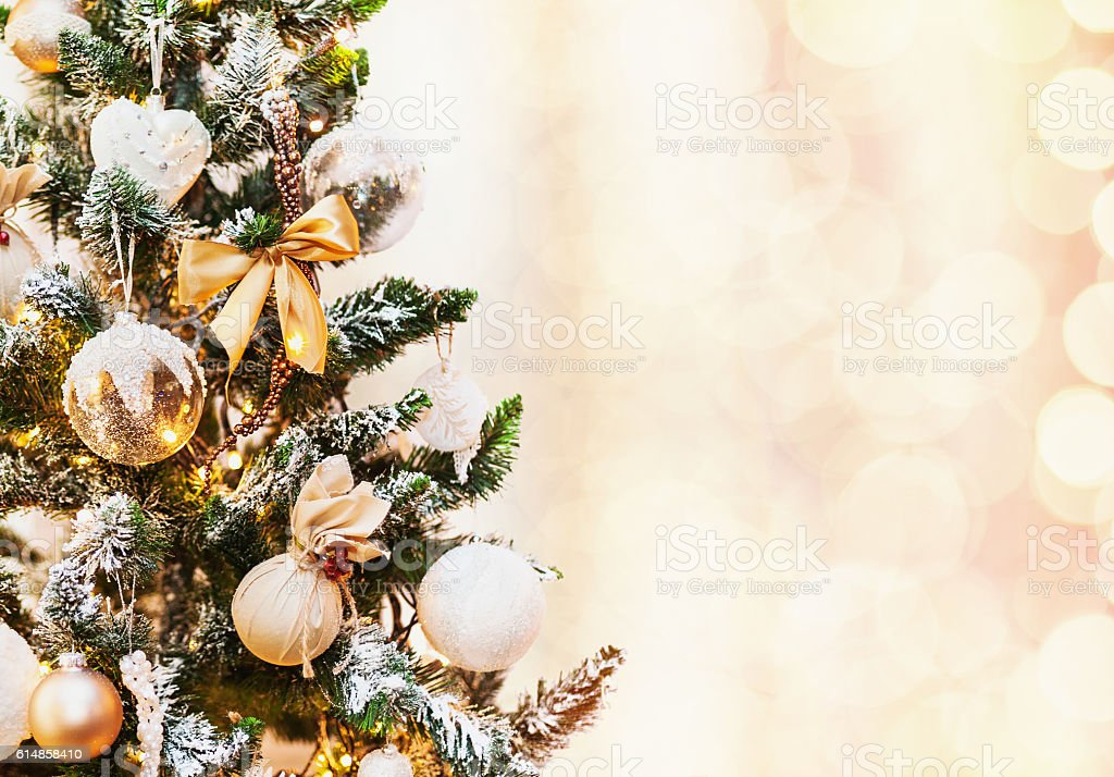 Decorated Christmas tree on holiday background stock photo