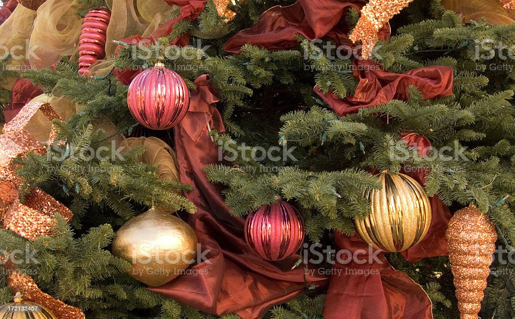 Decorated Christmas tree with empty space in the center. stock photo