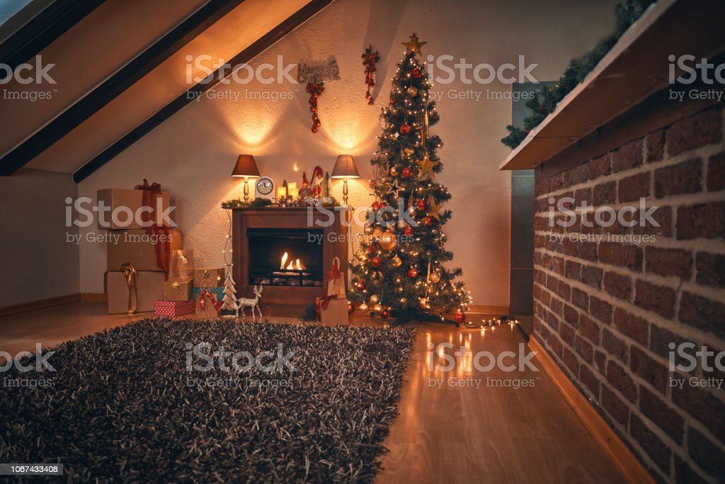 Decorated Christmas Tree with Ornaments and Holiday Lights in a Cozy...