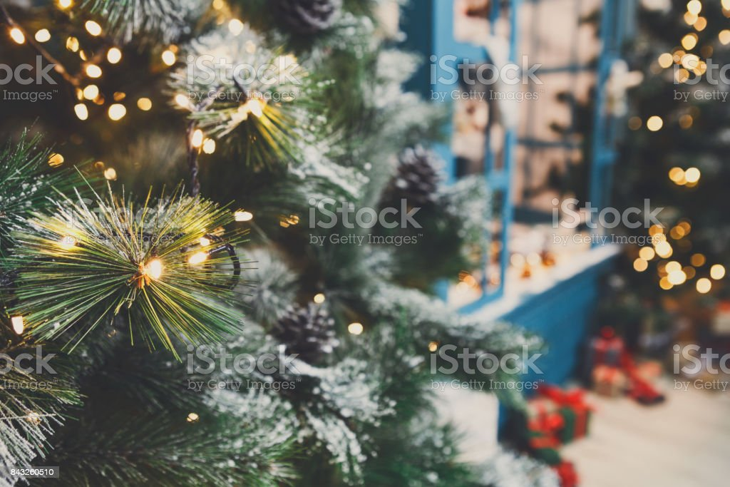 Decorated christmas trees in shiny garland background stock photo