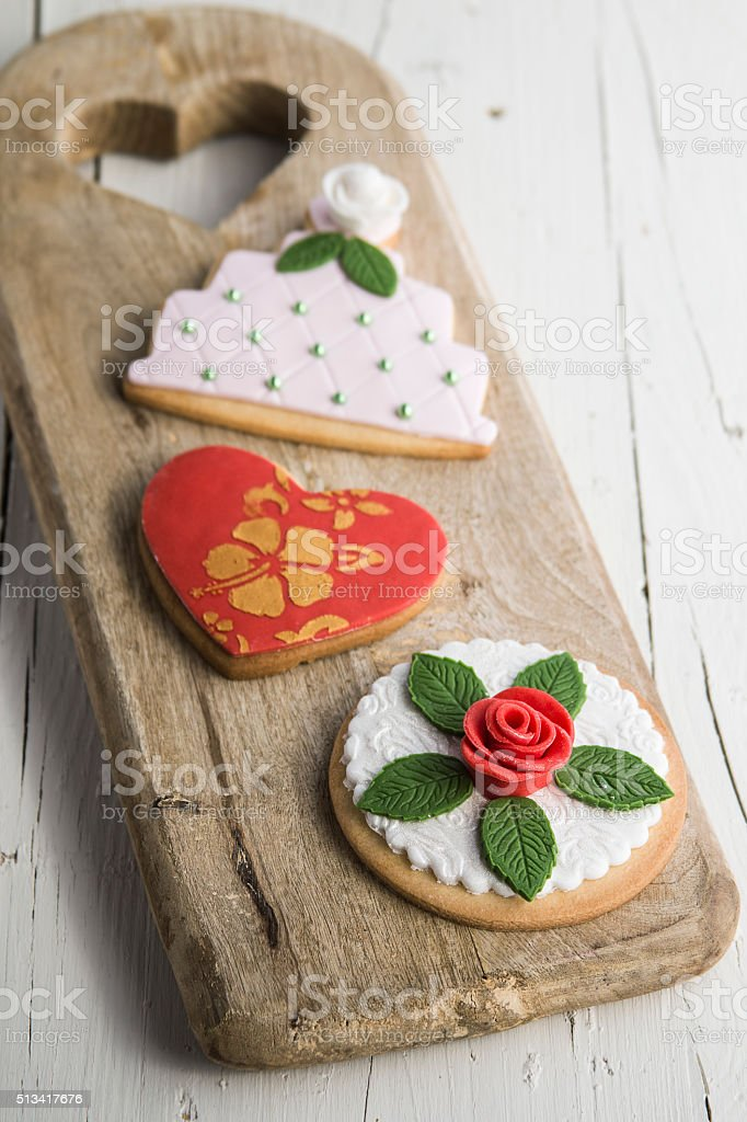 Decorated cookies with wedding, heart and flower cake shape stock photo