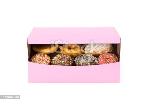 A partially opened doughnut box revealing a view of a variety of decadent doughnuts inside. Background is 255 white.