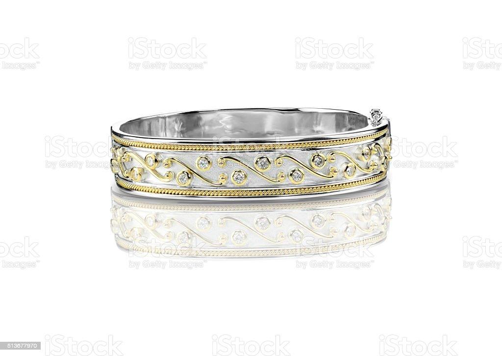 Decorated Duotone diamond gold Bracelet stock photo
