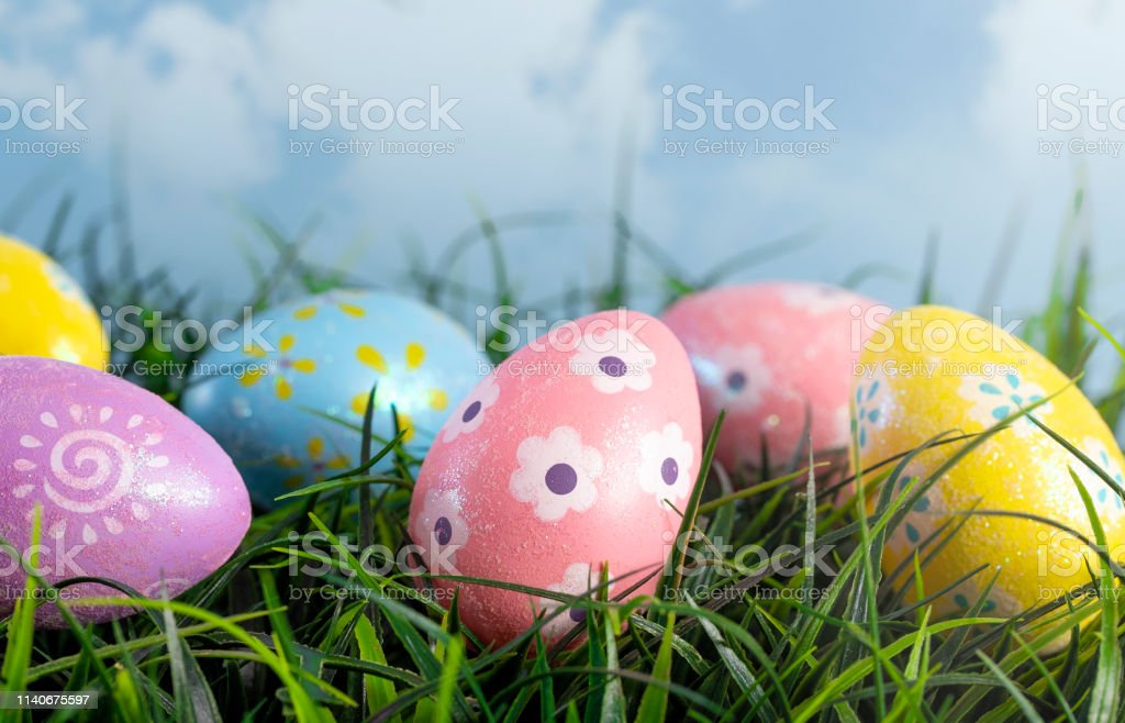 Decorated Easter Eggs Hiding in the Grass on a Beautiful Spring Day royalty-free stock photo
