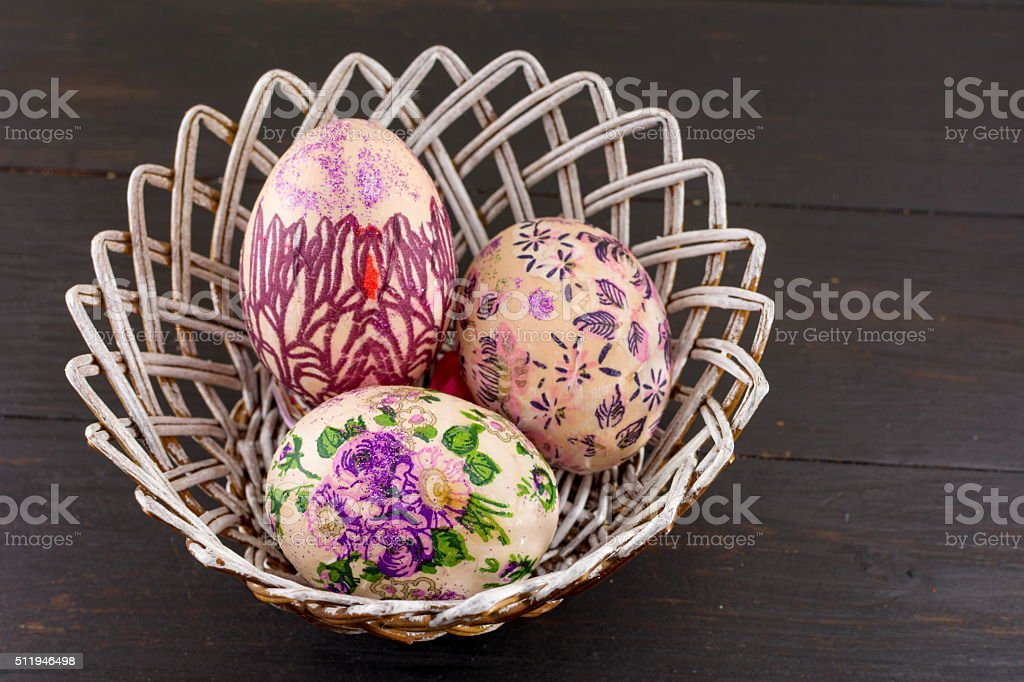 Decorated Easter eggs in a basket stock photo