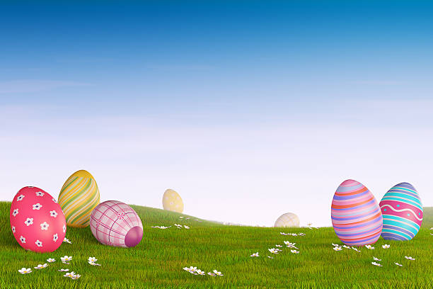 Decorated Easter eggs in a grassy hilly landscape stock photo