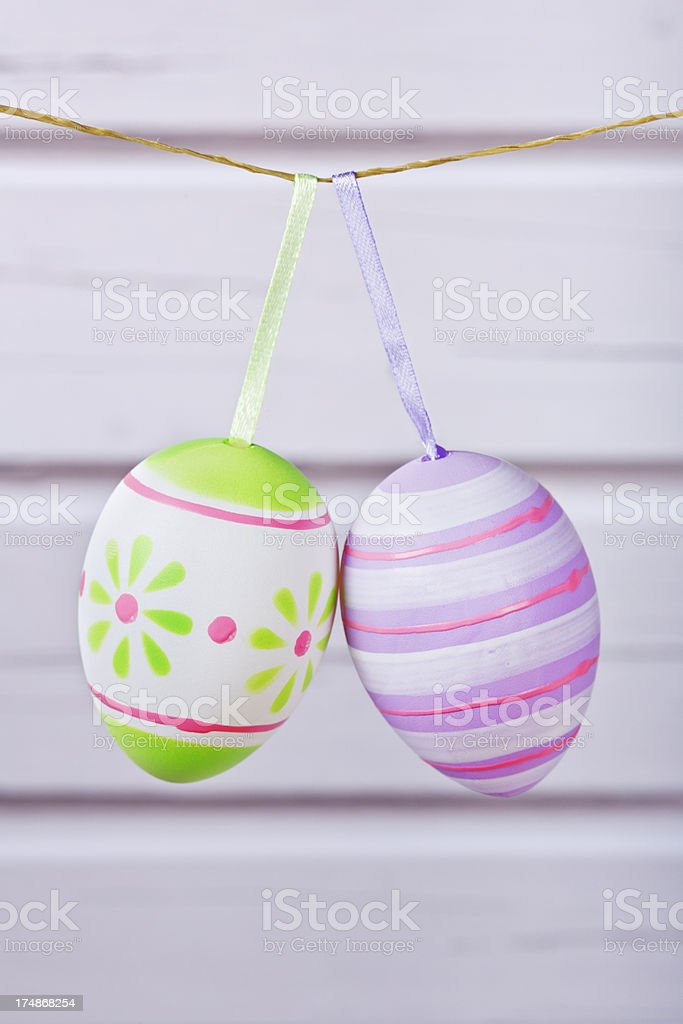 Decorated Easter eggs on a line with a rustic background royalty-free stock photo