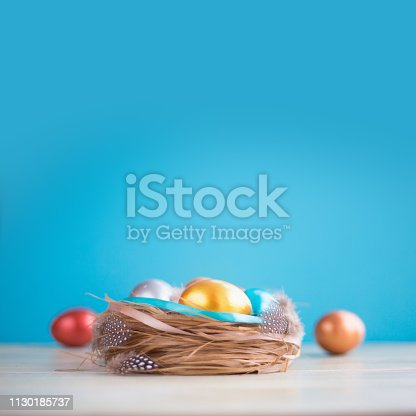 922843504 istock photo Decorated easter nest with eggs 1130185737
