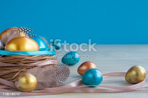 922843504 istock photo Decorated easter nest with eggs 1130185747
