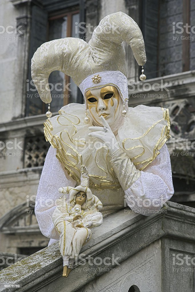 Decorated female mask with white jester costume in Venice (XXL) royalty-free stock photo