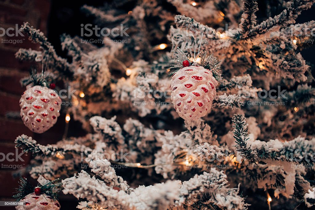 Decorated fir tree imitation with the snow on branches stock photo