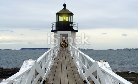 Marshall Point Lighthouse, located Port Clyde, Rockland Maine.  The lighthouse is decorated for Christmas holiday season.