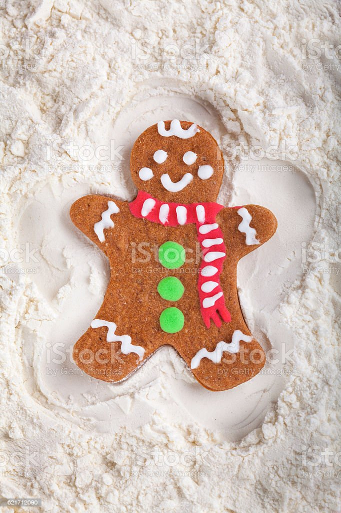 Decorated Gingerbread cookie man Snow Angel stock photo