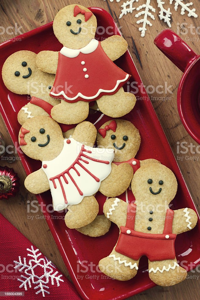 Decorated gingerbread cookies on a red tray stock photo