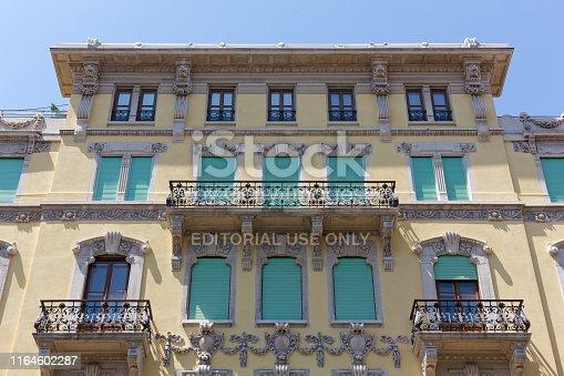 TRIESTE, Italy - June 16, 2019: Decorated exterior facade of an elegant historic building in Battisti street