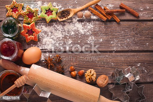 istock Decorated Holiday Christmas Gingerbread Cookies on wooden table. 623375978