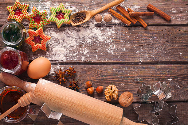 decorated holiday christmas gingerbread cookies on wooden table. - aufstrich weihnachten stock-fotos und bilder