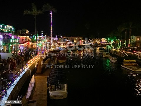 Each year residents of Naples Island in Long Beach, CA light up their houses with a spectacular display of Christmas lights and decorations. Visitors stroll past the homes or take boat rides along the canals to enjoy the festive display.