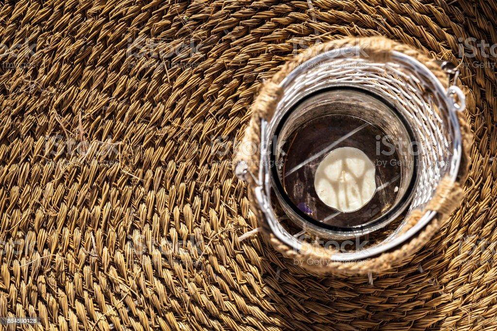 Decorated lantern over esparto fiber carpet stock photo