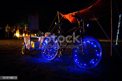Decorated LED lights bicycle at night blue lights