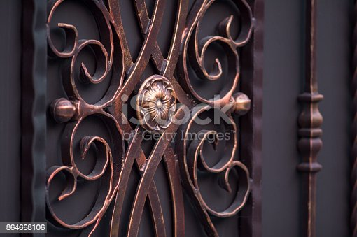 istock decorated magnificent wrought-iron gates, ornamental forging, forged elements close-up 864668106