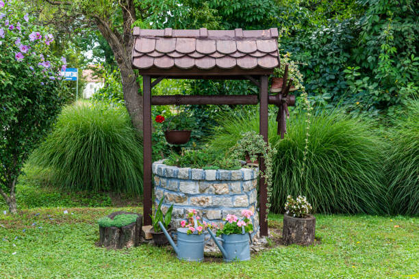 Decorated old water well stock photo