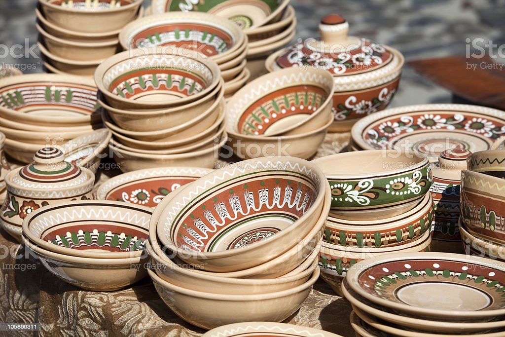 Decorated pottery collection at the handicraft market royalty-free stock photo