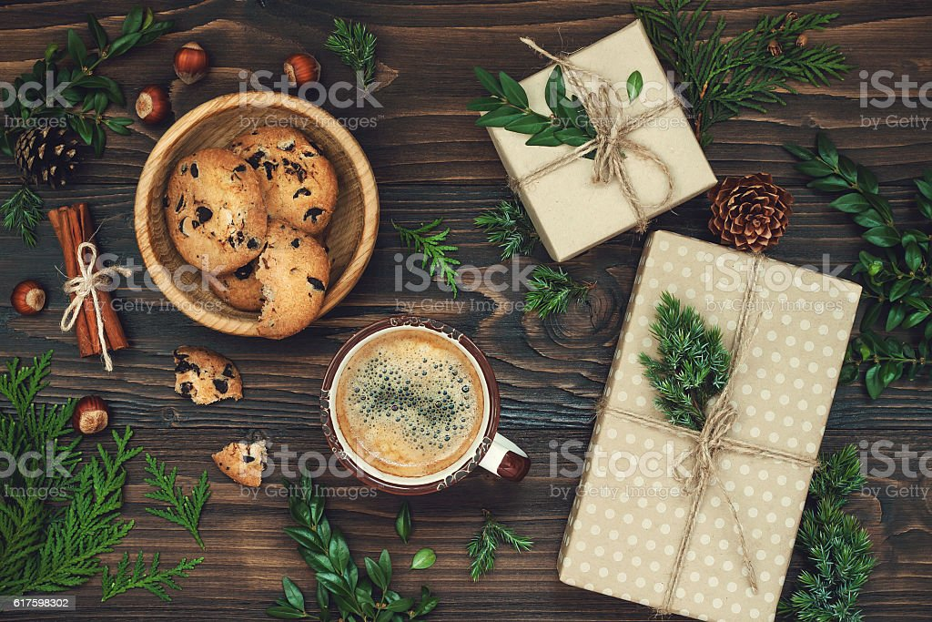 Decorated  presents on rustic wooden table. Ideal Christmas morning breakfast. stock photo